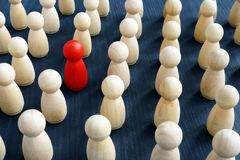 Personal development. Red figure in a crowd. Think different. Personal development concept. Red figure in a crowd. Think different stock photography