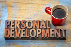 Personal development word abstract. Personal development - word abstract in vintage letterpress wood type with a cup of coffee Stock Photos