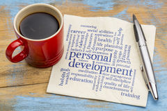 Personal development word cloud on napkin. Personal development word cloud - handwriting on a napkin with a cup of coffee stock images