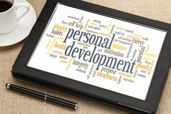 Personal development word cloud. Cloud of words or tags related to personal development on a  digital tablet Royalty Free Stock Image