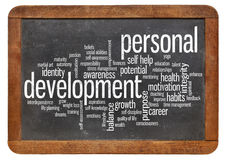 Personal development word cloud. Cloud of words or tags related to personal development  on a  vintage slate blackboard isolated on white Royalty Free Stock Photos