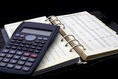 Personal diary and calculator. On the table Stock Photos