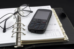 Personal diary and mobile phone Royalty Free Stock Photo