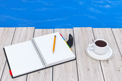 Personal Diary or Organiser Book with Pencil and Cup of Coffee i. N front of Ocean extreme closeup. 3d Rendering Stock Images