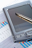 Personal digital assistant on market financial chart background royalty free stock image