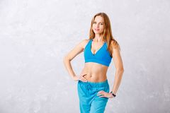 Personal fitness aerobic coach on grey background royalty free stock photography