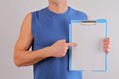 Personal fitness trainer with  workout plan close up. Copy space fitness background Royalty Free Stock Photos