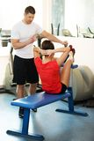 Personal fitness trainer and young woman royalty free stock photo