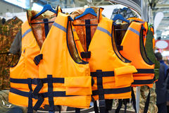 Personal flotation device as life jacket in store Royalty Free Stock Photos