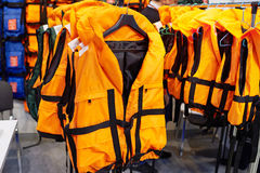 Personal flotation device as life jacket in store stock images