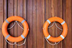 Personal flotation device hanging on the wall. Personal flotation device hanging on hooks on the wooden wall. Personal flotation device also referred to as a royalty free stock images