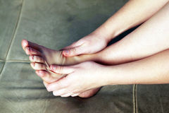 Personal foot massage. On pressure points Stock Photos