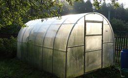 Personal greenhouse for cucumbers in the country. stock image