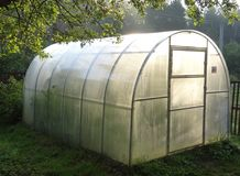 Free Personal Greenhouse For Cucumbers In The Country. Stock Images - 115348674
