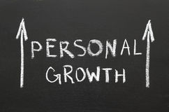 Personal growth. Phrase handwritten on the chalkboard with rising arrows Stock Photo