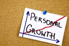 A yellow sticky note writing, caption, inscription personal growth - handwriting in a black ink on cork notice board stock photos