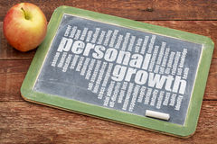 Personal growth word cloud on blackboard Royalty Free Stock Photo