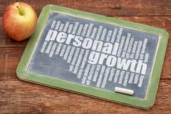 Personal growth word cloud on blackboard. Personal growth word cloud on a slate blackboard with apple royalty free stock photo