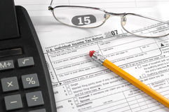 Personal income taxes. Tax form indicating tax deadline of april 15th Stock Photography