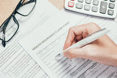 Personal information on the health insurance claim form Stock Photos