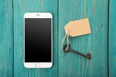Personal information security concept. Smartphone with keys royalty free stock photography