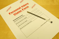 Personal Injury Claim Form. A Personal Injury Claim Form on a table with a pen placed on top Royalty Free Stock Photography