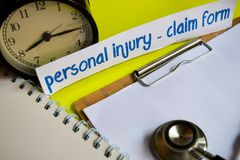 Personal injury - Claim form on healthcare concept inspiration on yellow background stock photos