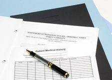 Personal Injury Form. Statement of personal injury form with patient chart and pen Stock Images