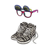 Personal items from 90s - high sneakers, sunglasses with removable lenses Royalty Free Stock Photo