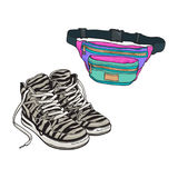 Personal items from 90s - zebra patterned sneakers, colorful waist bag Royalty Free Stock Image