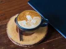 Personal laptop computer with cup of coffee on a wooden table Stock Images