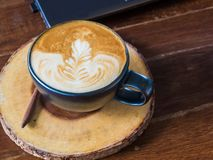 Personal laptop computer with cup of coffee on a wooden table Stock Photo