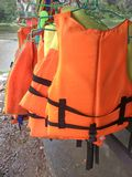 Personal life support flotation safety device life jacket, life vest, work vest, life saving, buoyancy aid or flotation suit for. Marine personnel working on stock photography