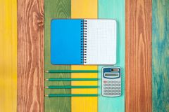 Personal organizer,calculator and four pencil Stock Images