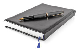 Personal organizer with ink pen Stock Photography