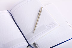 Personal organizer, notebook and pen. On white Royalty Free Stock Photos