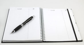 Personal organizer with pen Stock Photo