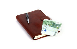 Personal organizer with pen and euros. Personal organizer pen euros bonds royalty free stock images