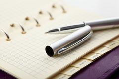 Personal organizer with pen Stock Photography