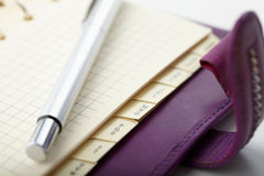 Personal organizer with pen Stock Images