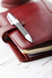 Personal organizer with pen Royalty Free Stock Images