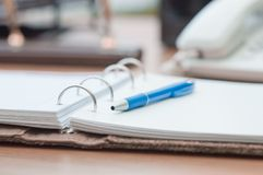 Personal organizer and pen on office desk Royalty Free Stock Images