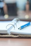 Personal organizer and pen on office desk Stock Images