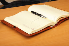 Personal organizer and pen on the table Royalty Free Stock Photos