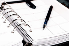 Personal organizer or planner with pen on white background Royalty Free Stock Photos