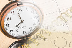 Personal organizer and pocket watch. Royalty Free Stock Photos