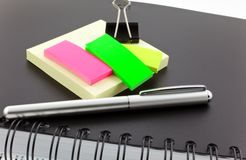 Personal organizer, post-its and steel clip Stock Photos