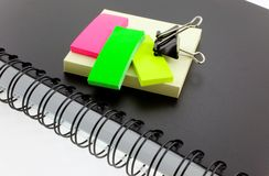 Personal organizer, post-its and steel clip Royalty Free Stock Photos