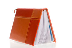 Personal organizer standing on its cover, isolated Stock Images