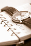 Personal organizer and watch. (shallow focus Royalty Free Stock Photos